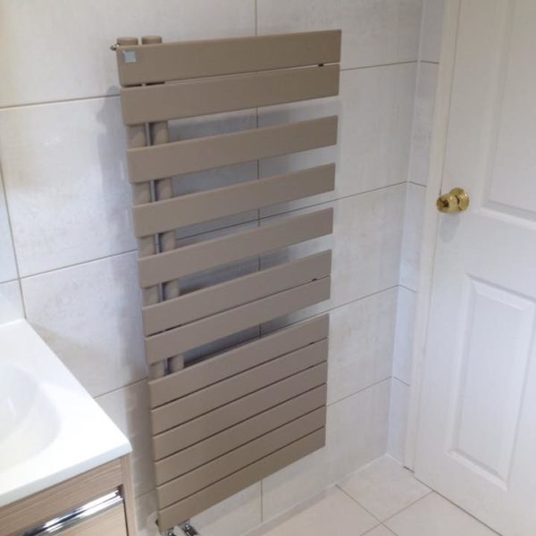 Sleek heated towel rail in bathroom