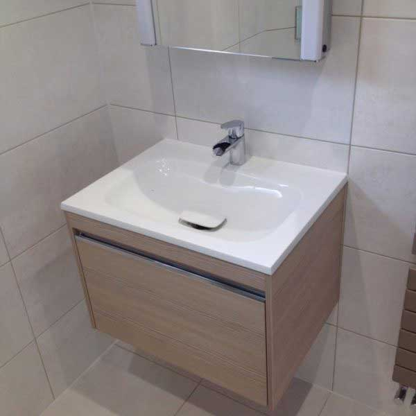 Floating sink and mirror in bathroom
