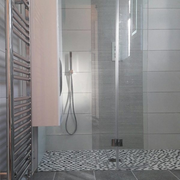 Grey and white easy access shower
