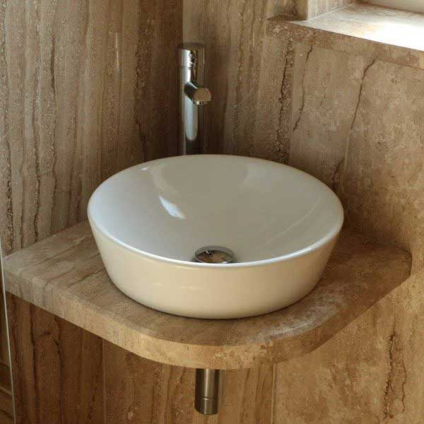 Ensuite bathroom sink with wood effect tiles