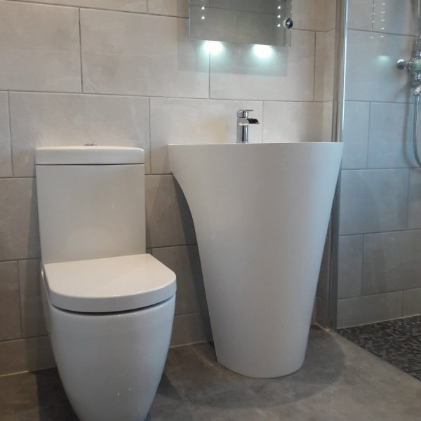 Ensuite bathroom in grey and white