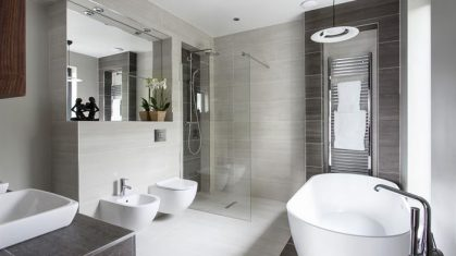 Cream and Dark Bathroom with Large Bath and Walk in Shower