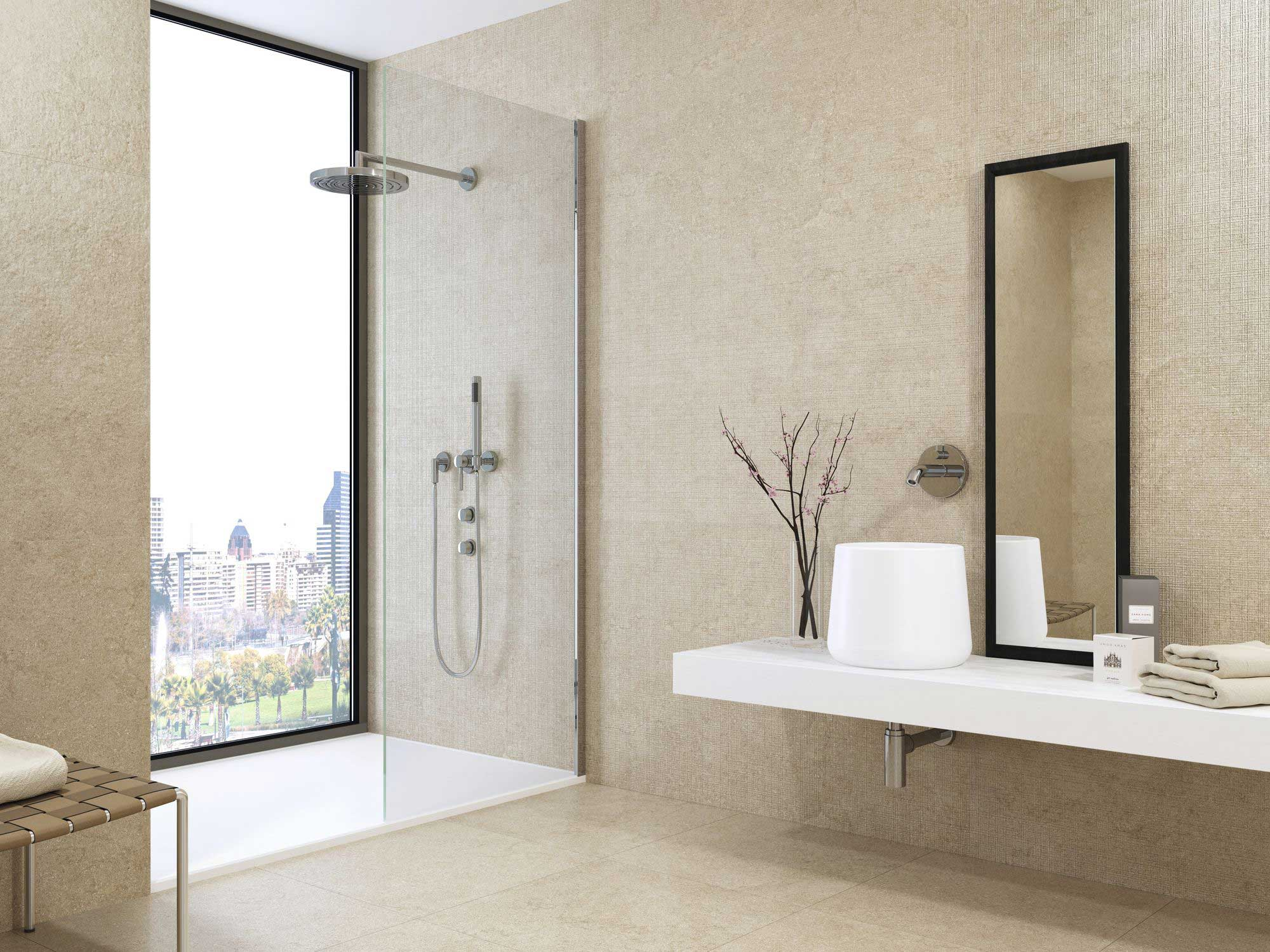 Beige tiled bathroom