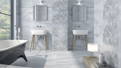 Light Blue and Grey Tiled Bathroom with Two Free Standing Sinks