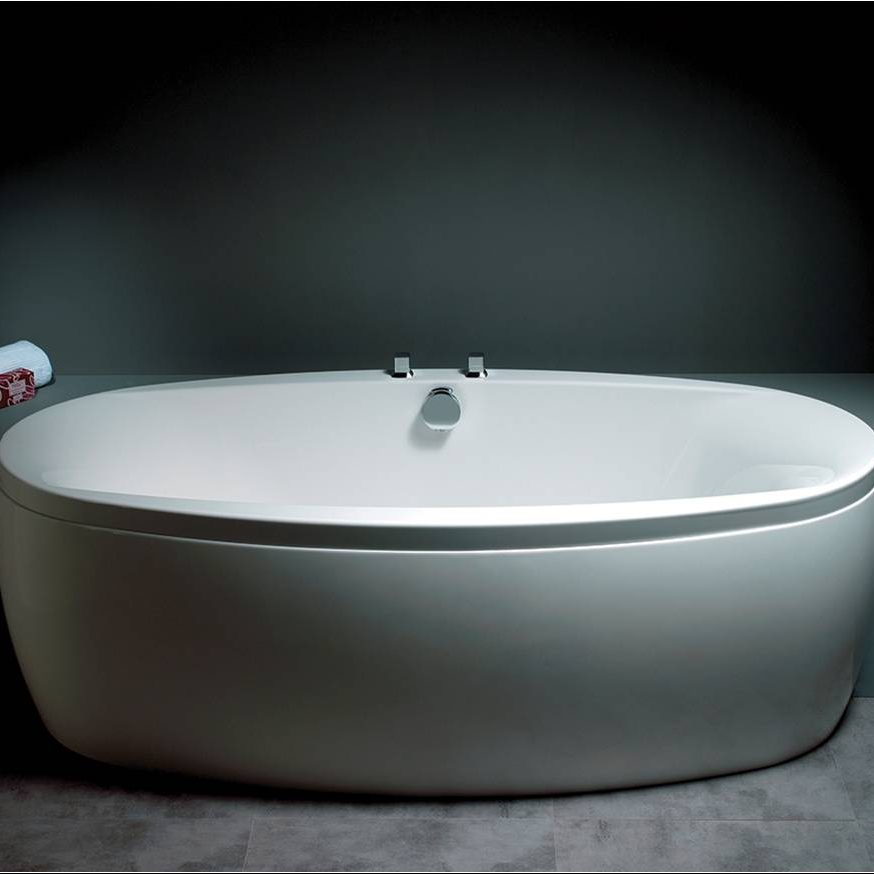 White Oval Bath in Dark Bathroom