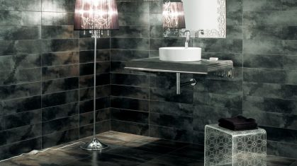 Iron Tiles in Dark Bathroom With a White Sink