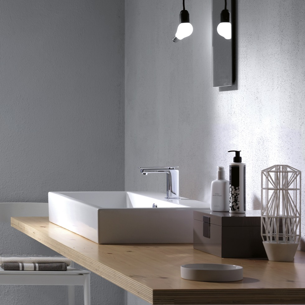 White Sink on Wooden Stand in Grey Bathroom