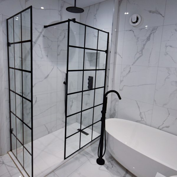 Shower and Bath In Marble Bathroom